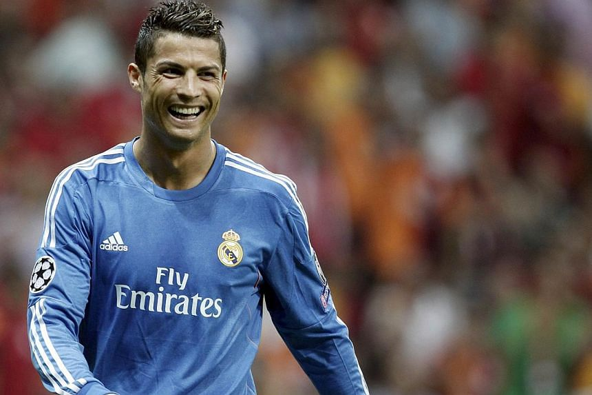 Cristiano Ronaldo celebrated the signing of his new contract with Real Madrid in stunning fashion with his 23rd career hat-trick as the Spanish giants hammered Galatasaray 6-1 at the Turk Telekom Arena on Tuesday. -- PHOTO: REUTERS