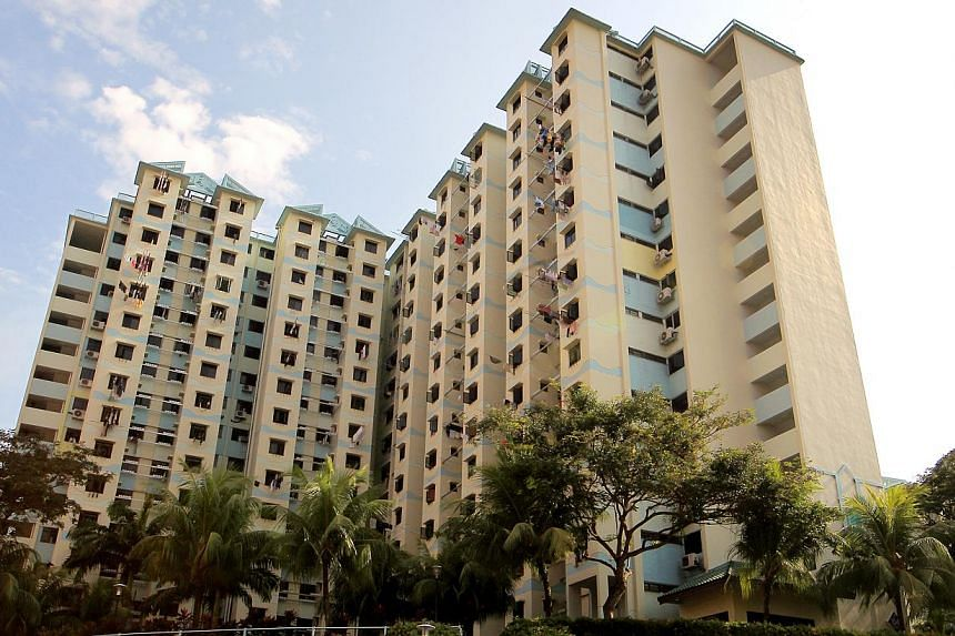 HDB flats in Queenstown, Singapore. The Housing Board has expanded the scheme that caters to families waiting for their new flats to include divorcees, as well as couples that include someone who has previously enjoyed a housing subsidy. -- FILE PHOT