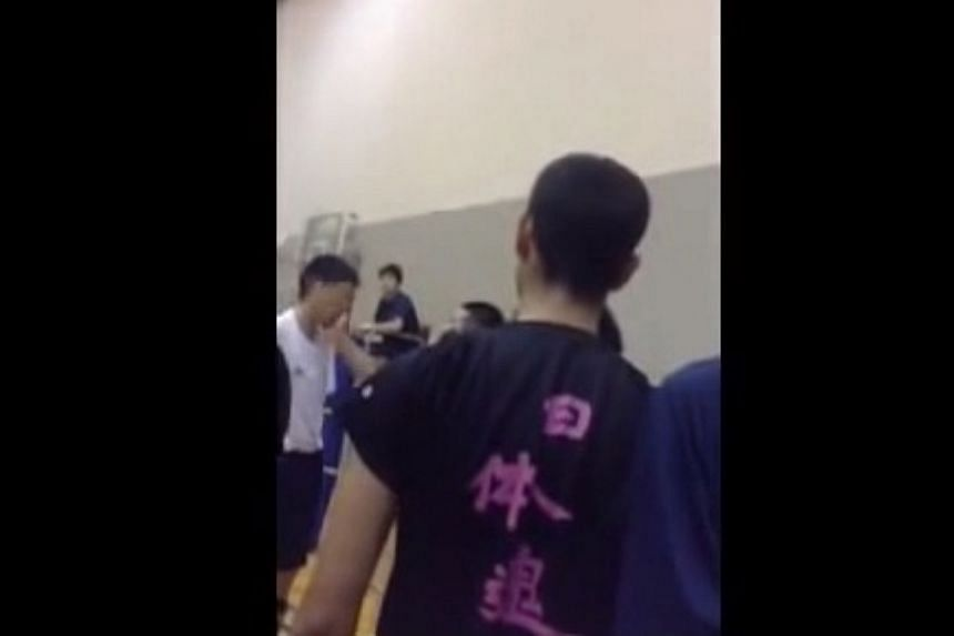 A screengrab from a video showing a volleyball coach repeatedly slapping a schoolboy. The short clip posted on YouTube showed the teacher at Hamamatsu Nittai Senior High School in central Japan smacking the student's face at least 13 times in 16