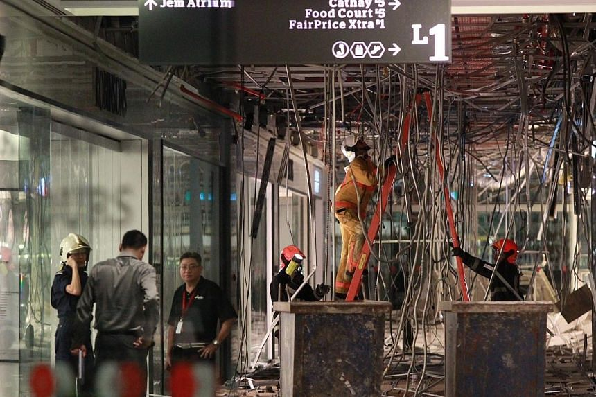 Three individuals are believed to be injured after the first-floor ceiling of Jem mall collapsed due to a burst water pipe. -- ST PHOTO: NEO XIAOBIN