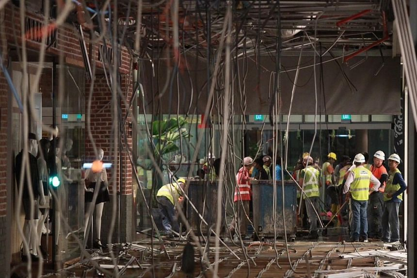 Three individuals are believed to be injured after the first-floor ceiling of Jem mall collapsed due to a burst water pipe.-- ST PHOTO: NEO XIAOBIN