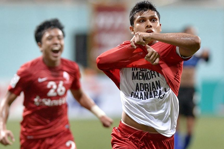 Fazrul Nawaz (right) celebrates his goal with Shahfiq Ghani, revealing a white T-shirt which pays tribute to former Singapore national player Adrian Dhanaraj, who passed away last week after losing a battle against Hodgkin's lymphoma. Fazrul's s