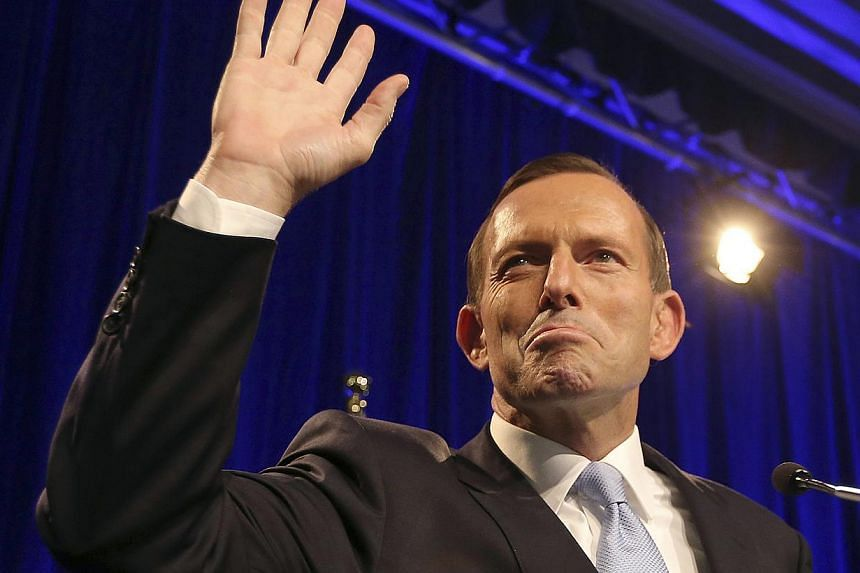 In this Sept 7, 2013 file photo, Australian opposition leader Tony Abbott arrives on stage to deliver his victory speech in Australia's national election in Sydney.Abbott was sworn in as Australia's new prime minister on Wednesday, officially e