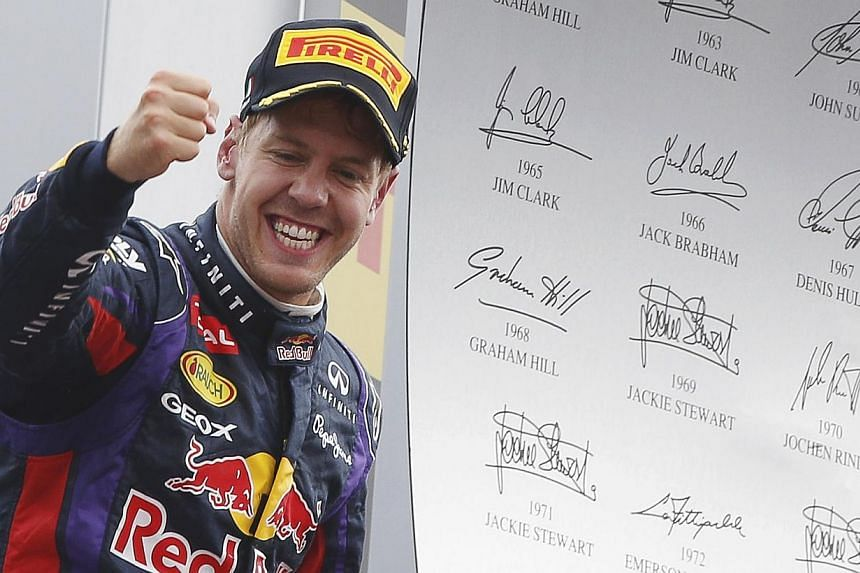 Red Bull Formula One driver Sebastian Vettel of Germany celebrates winning the Italian F1 Grand Prix at the Monza circuit Sept 8, 2013. Vettel looks set to extend his mastery of Formula One this week but neutrals and his rivals will be hoping for a d