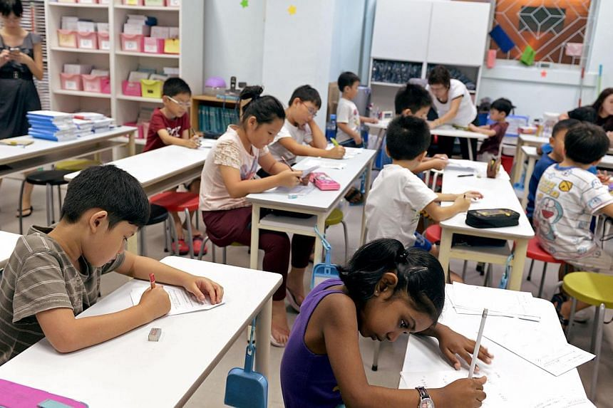 """Students attend a tuition class on Sept 14, 2012. Tuition is needed to maintain a competitive edge in school, said parents and students, in response to Senior Minister of State Indranee Rajah who had said tuition is """"not necessary"""". -- ST FILE PHOTO:"""