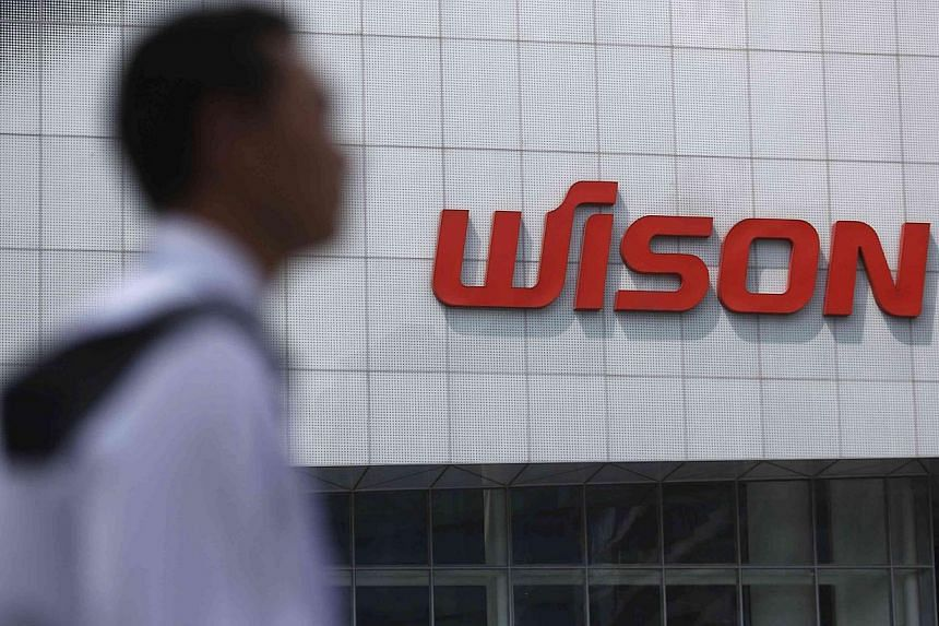A security guard patrols outside Wison Engineering Services Co Ltd in Shanghai on Sept 3, 2013. Wison, a supplier to PetroChina , said Chinese authorities had taken company records and temporarily frozen some its bank accounts amid a widening probe i