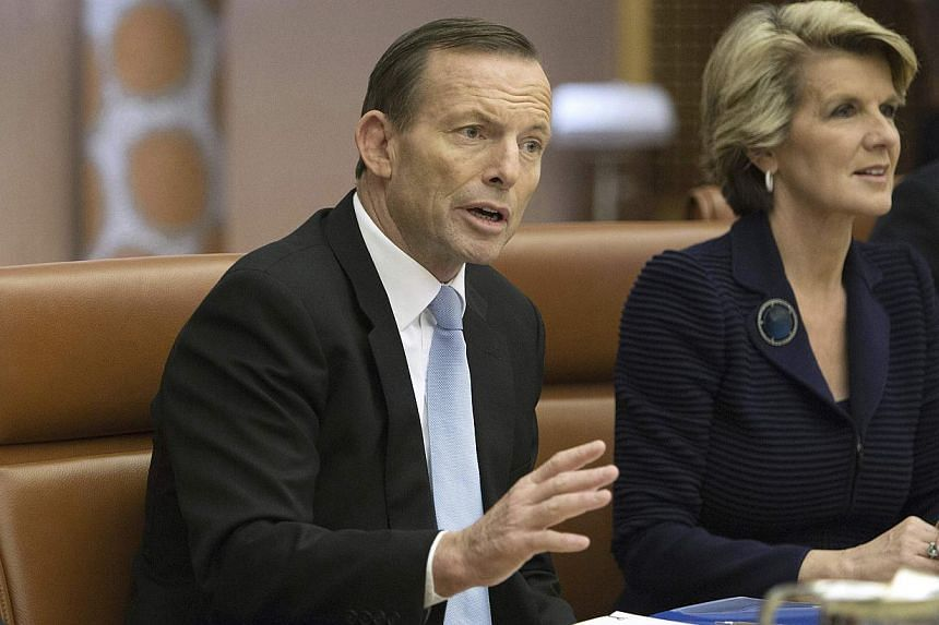Australia's new conservative Prime Minister Tony Abbott gestures next to his Foreign Minister Julie Bishop during the first meeting of his full ministry in the Cabinet Room of Parliament House in Canberra on Sept 18, 2013. Mr Abbott on Thursday said