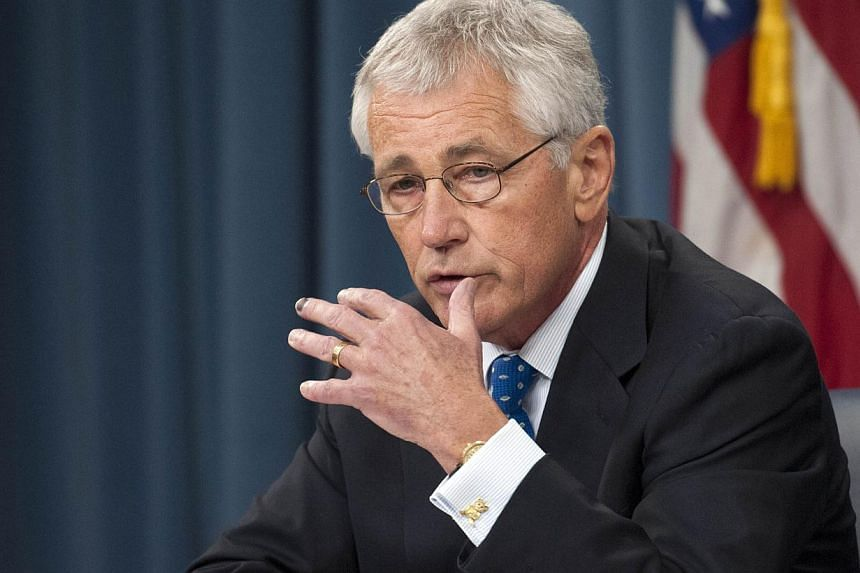 Secretary of Defense Chuck Hagel responds to a question from a reporter as he and Chairman of the Joint Chiefs of Staff Gen. Martin E. Dempsey brief the press at the Pentagon, September 18, 2013 in Arlington, Virginia.US Defence Secretary Chuck