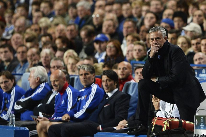 Chelsea's manager Jose Mourinho watches his team during their Champions League soccer match against Basel at Stamford Bridge in London September 18, 2013. Jose Mourinho's return to the Champions League with Chelsea started in dismal fashion as F