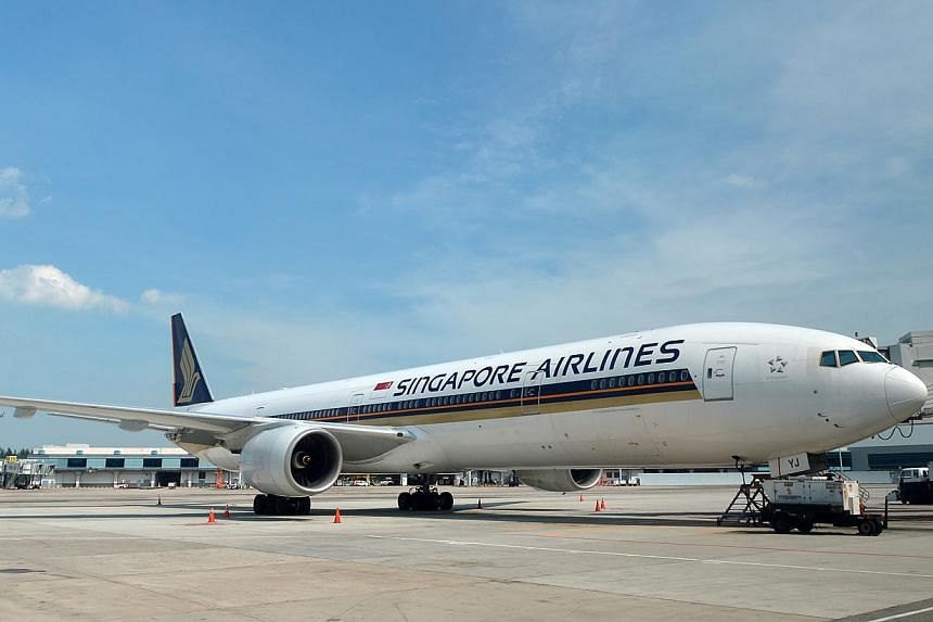 A Singapore Airlines (SIA) aircraft at the Changi Airport on April 18, 2013. Singapore Airlines has joined hands with India's Tata Sons to start a new full-service airline in New Delhi. -- ST FILE PHOTO: ALPHONSUS CHERN