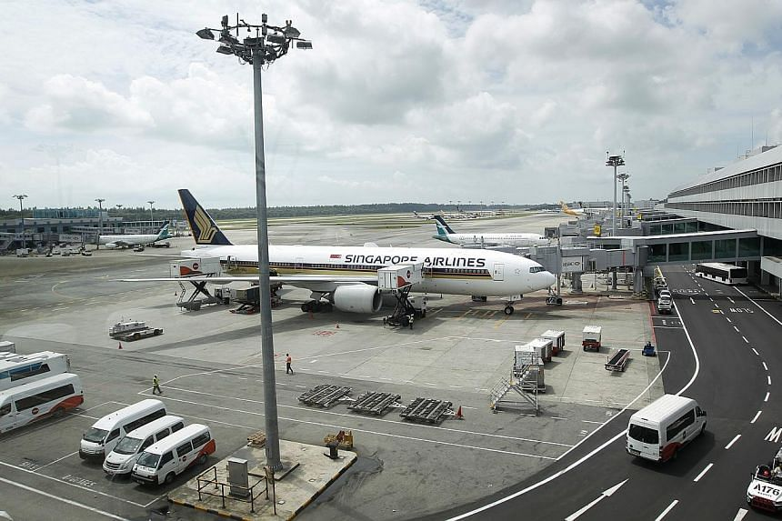 A Singapore Airlines carrier at Changi Airport Terminal 2 on Feb 7, 2013. India's Tata Sons conglomerate and Singapore Airlines will form a full-service airline based in New Delhi, the Indian group said on Thursday, Sept 19, 2013. -- ST FILE PHO