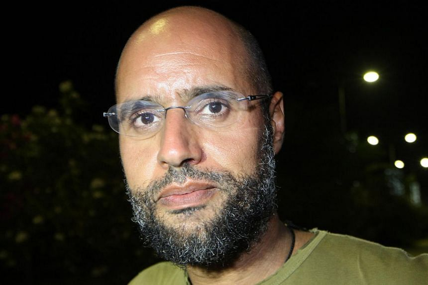 A picture taken on Aug 23, 2011, shows Seif al-Islam Gaddafi, son of slain Libyan dictator Muammar Gaddafi, appearing at his father's residential complex in the Libyan capital Tripoli. Seif al-Islam appeared in court on Thursday, Sept 19, 2013,