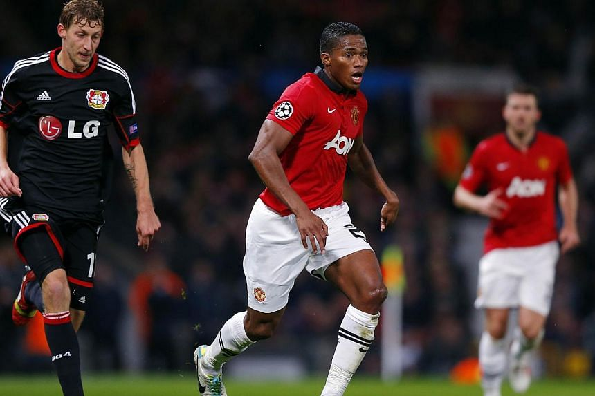 Manchester United's Ecuadorian forward Antonio Valencia (centre) controls the ball during the UEFA Champions League Group A football match football match between Manchester United and Bayer Leverkusen at Old Trafford in Manchester, north west England