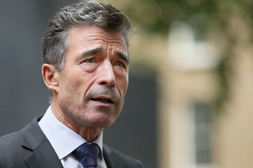 Nato Secretary General Anders Fogh Rasmussen speaks to the media after a meeting with Britain's Prime Minister David Cameron in 10 Downing Street in London on Wednesday, Sept 18, 2013. Mr Rasmussen urged Europe on Thursday, Sept 19, 2013, to sha
