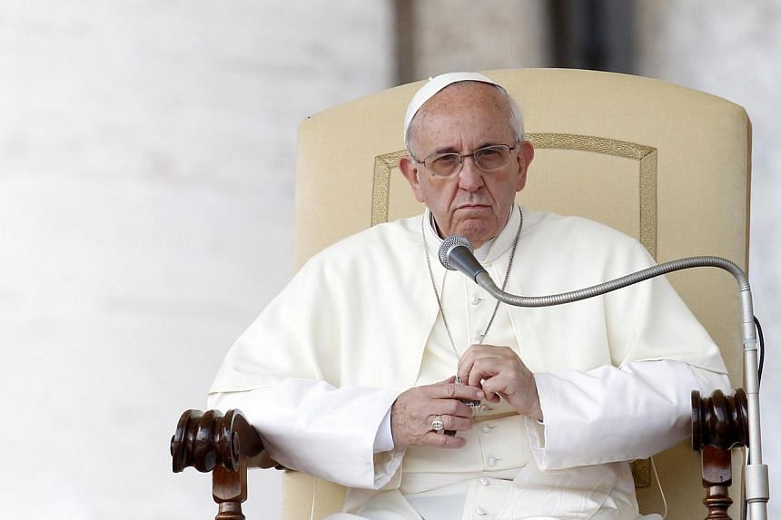 "Pope Francis looks on during his weekly general audience in St Peter's Square at the Vatican on Wednesday, Sept 18, 2013. Pope Francis on Thursday, Sept 19, 2013, lashed out at what he called the scandal of ""airport bishops"", urging his peers to"