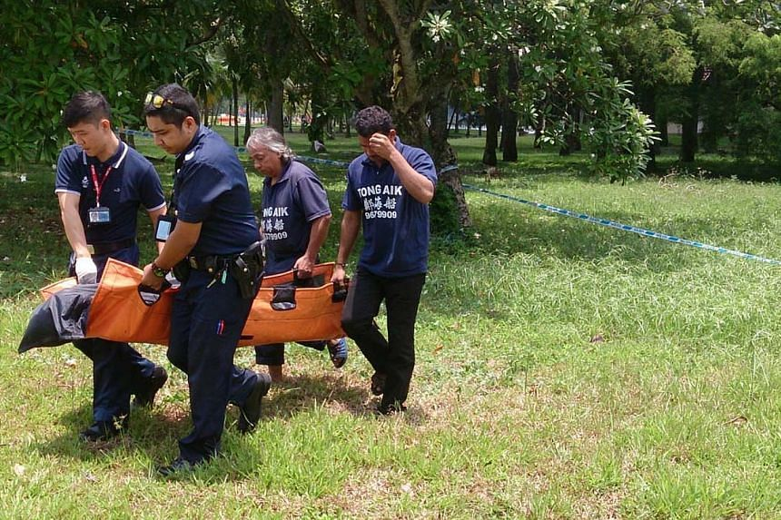A body was found along the Kallang River, off Geylang Road, near the old People's Association headquarters on Thursday, Sept 19, 2013.-- ST PHOTO: LAU FOOK KONG