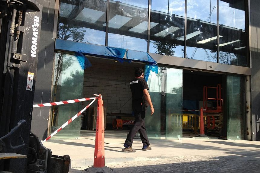 A JEM security staff member patrols outside the mall on Sept 19, 2013. -- ST PHOTO: KUA CHEE SIONG