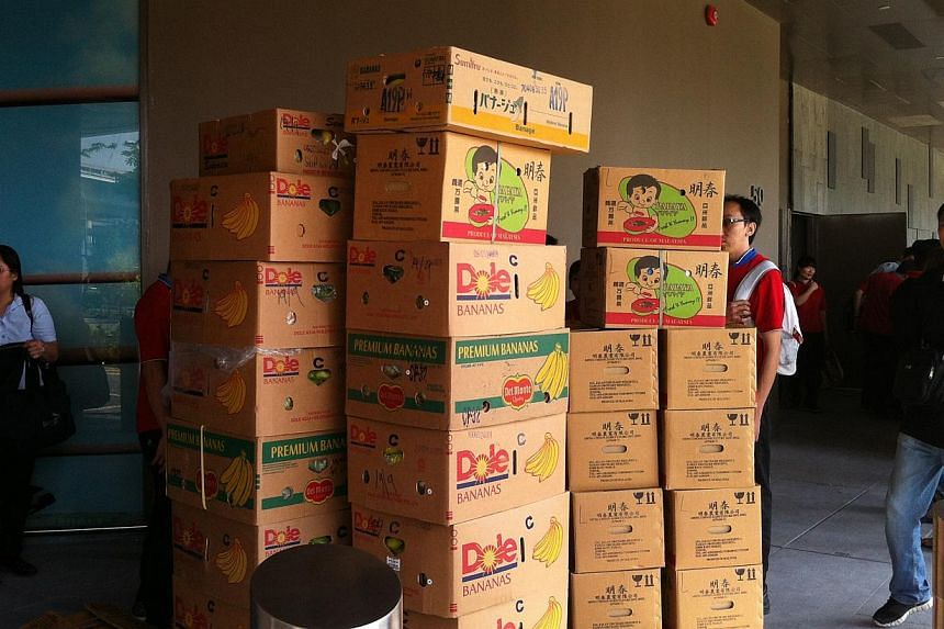 FairPrice staff transporting perishable goods to another outlet.-- ST PHOTO: JESSICA LIM