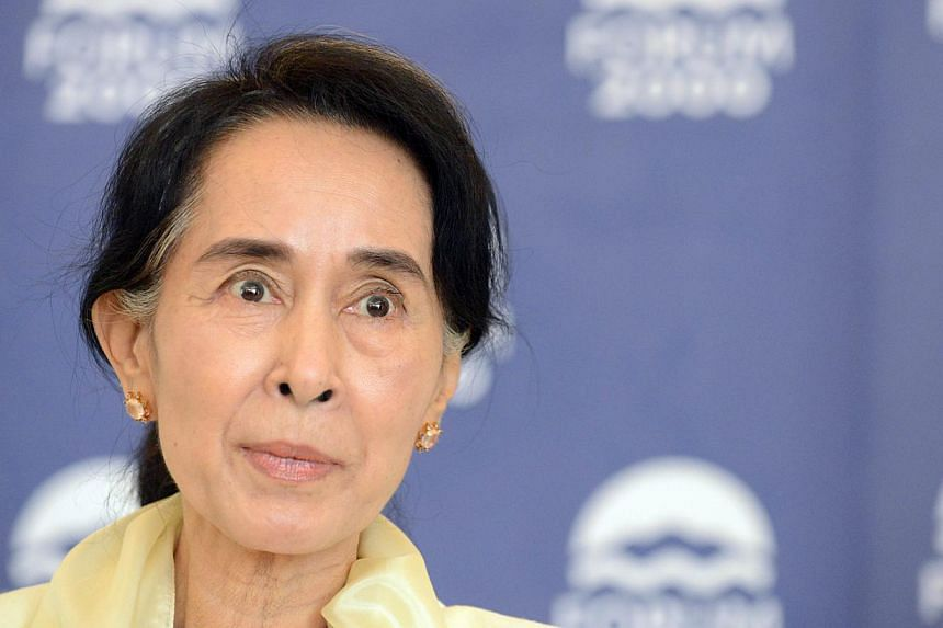 Ms Aung San Suu Kyi, Myanmar's opposition leader, begins a four-day visit to Singapore on Friday, Sept 20, 2013. -- PHOTO: AFP