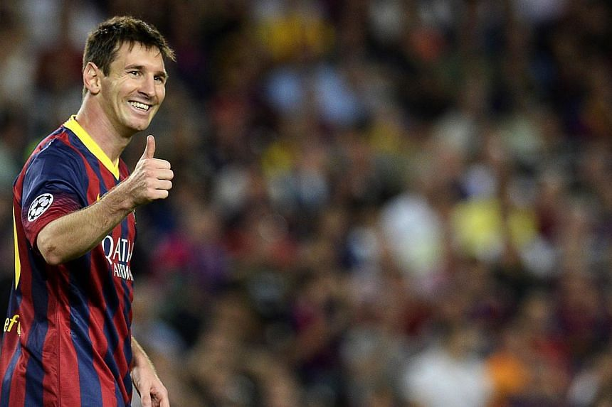 Lionel Messi moved into second place on the all-time list of Champions League goalscorers with his 27th career hat-trick as Barcelona beat Ajax 4-0 at the Nou Camp on Wednesday. -- PHOTO: AFP