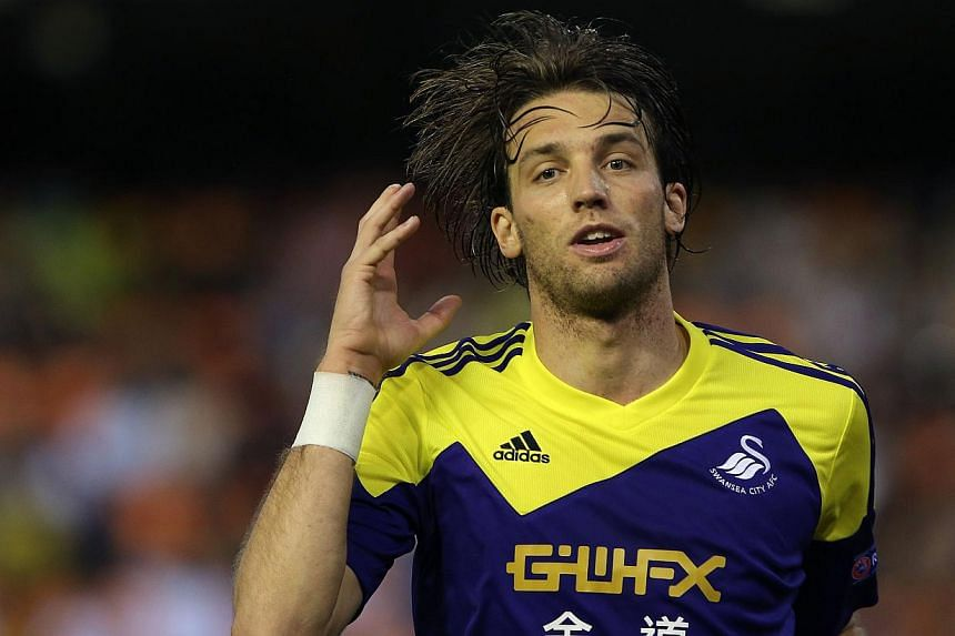 Swansea City's Spanish midfielder Miguel Michu celebrates after scoring during the Uefa Europa league football match Valencia CF vs Swansea City AFC at the Mestalla stadium in Valencia on Sept 19, 2013.Swansea City produced a remarkable perform