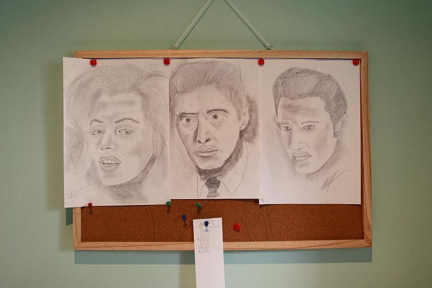 Sketches are seen on the wall of Tomislav Horvat's studio in Podturen, north Croatia, Thursday, Sept 19, 2013. -- PHOTO: REUTERS