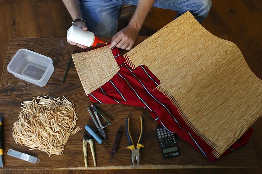 Tomislav Horvat, 24, works on a new sculpture made of matches in Podturen, north Croatia, Thursday, Sept 19, 2013. -- PHOTO: REUTERS