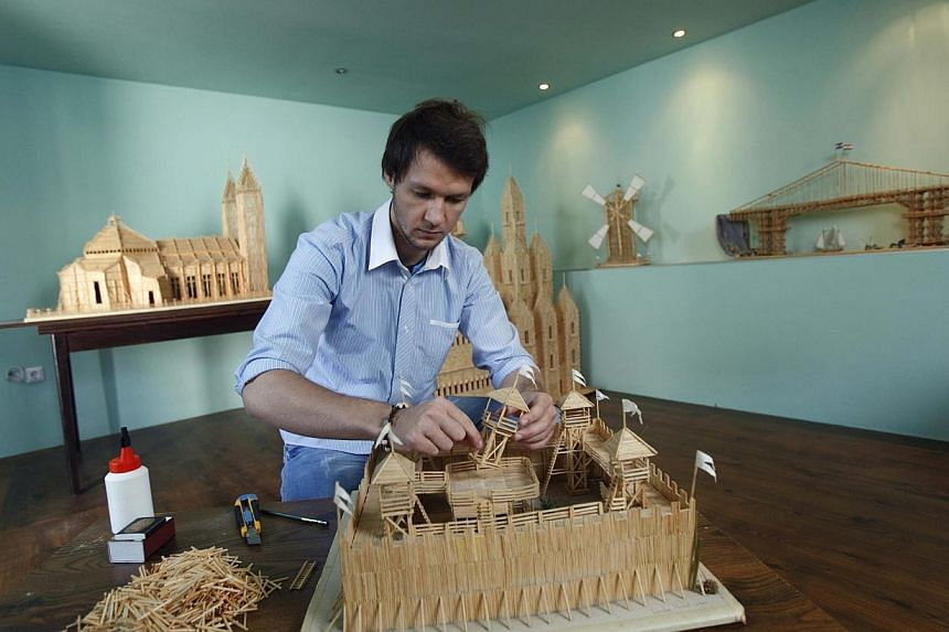 Tomislav Horvat, 24, fixes a sculpture made of matches in Podturen, north Croatia, Thursday, Sept 19, 2013. -- PHOTO: REUTERS