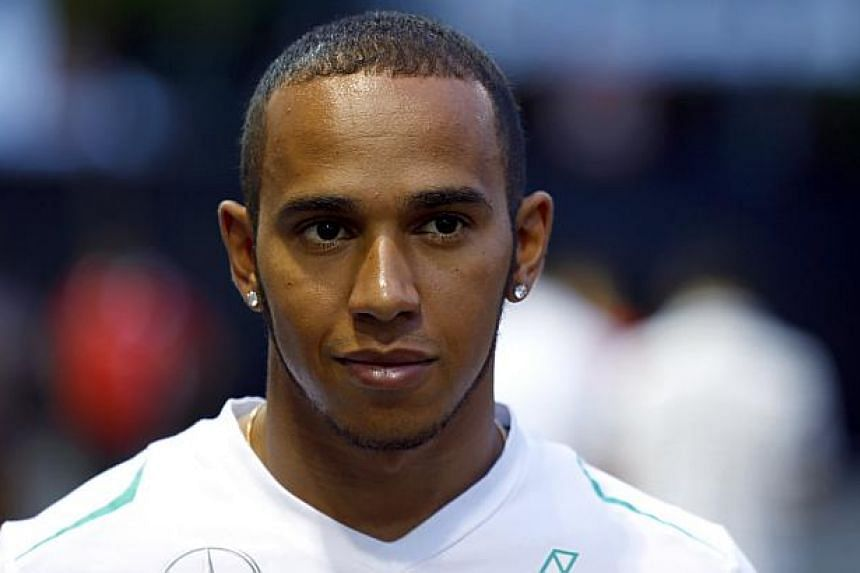Mercedes Formula One driver Lewis Hamilton of Britain walks in the paddock prior to the Formula One SingTel Singapore Grand Prix on Thursday, Sept 19, 2013. Hamilton took the first step toward bouncing back from his ninth-place finish at the Ita