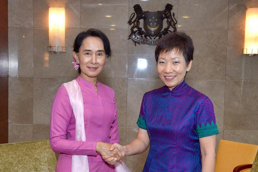 Myanmar's opposition leader Aung San Suu Kyi (left) began her first visit to Singapore on Friday,Sept 20, 2013,by calling on Second Minister for Foreign Affairs Grace Fu. -- ST PHOTO:DESMOND WEE
