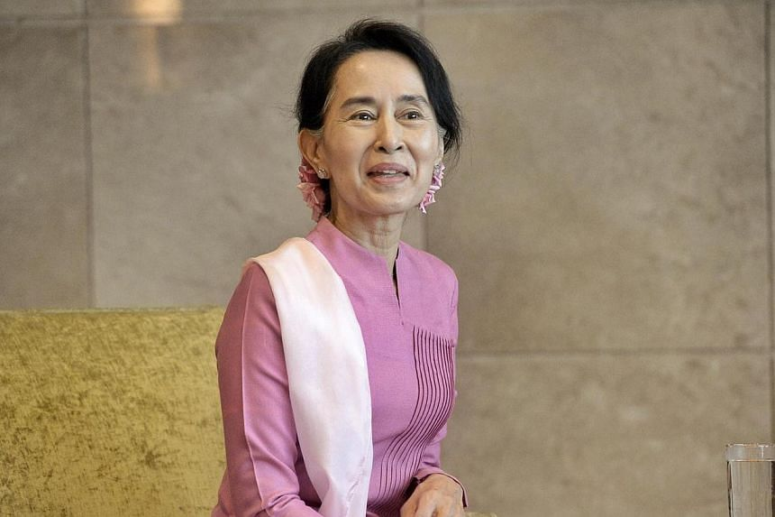 Myanmar's opposition leader Aung San Suu Kyi began her first visit to Singaporeon Friday,Sept 20, 2013,by calling on Second Minister for Foreign Affairs Grace Fu. -- ST PHOTO:DESMOND WEE