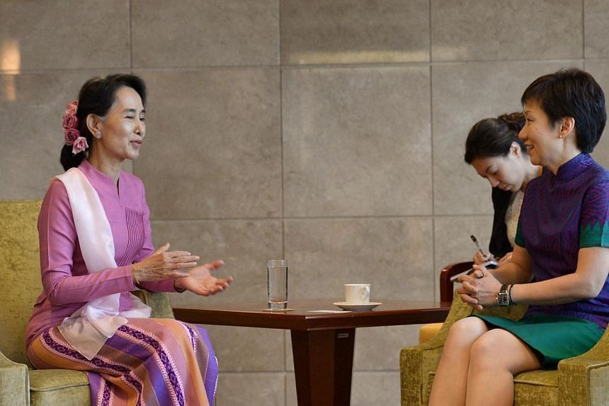 Myanmar's opposition leader Aung San Suu Kyi (left) began her first visit to Singaporeon Friday,Sept 20, 2013,by calling on Second Minister for Foreign Affairs Grace Fu. -- ST PHOTO:DESMOND WEE