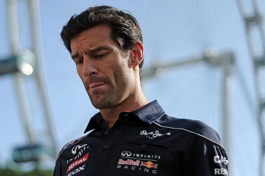 Red Bull driver Mark Webber of Australia arrives at the paddock ahead of the first practice session of the Formula One SingTel Singapore Grand Prix night race on Friday, Sept 20, 2013.Webber could have stayed in Formula One and challenged for g
