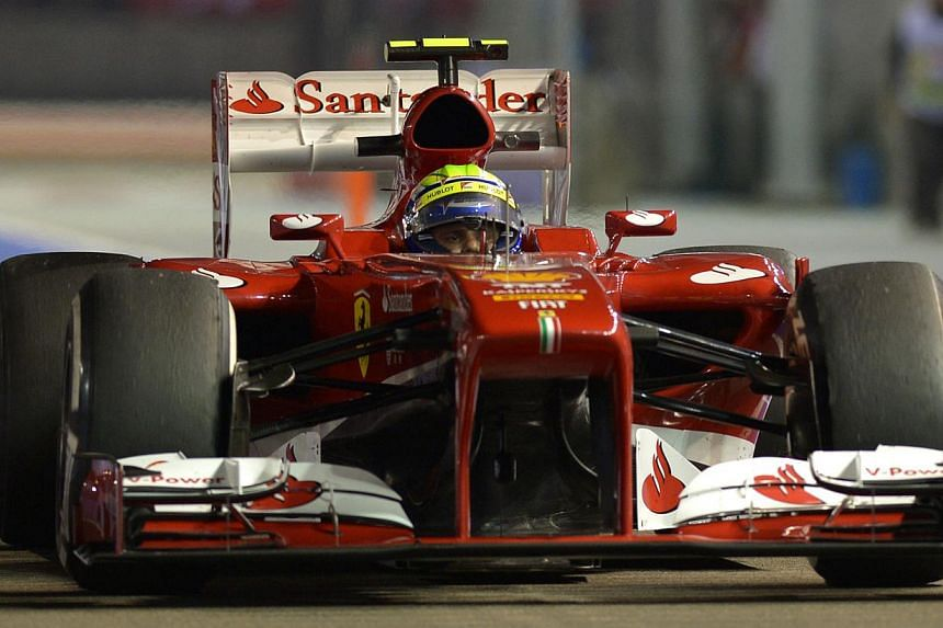 Ferrari F1 driver Felipe Massa returns to the pit lane after the first practice session of the Formula One Singapore Grand Prix 2013 on Friday, Sept 20, 2013. -- ST PHOTO: CAROLINE CHIA