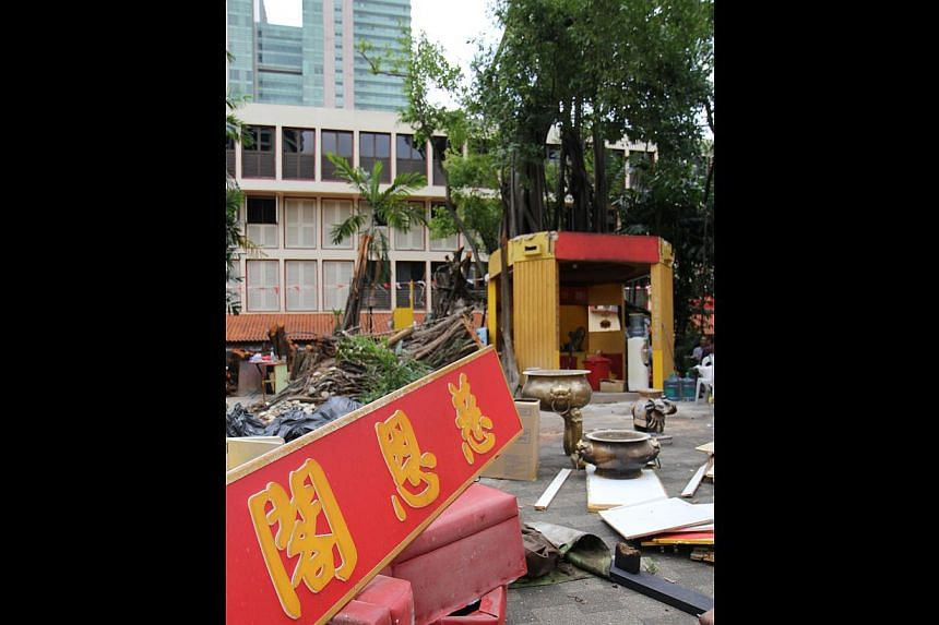 DOWN, BUT NOT OUT: The shrine may have been damaged, but plans are under way for a new shrine to be built by early next year. -- PHOTO: RAZOR TV