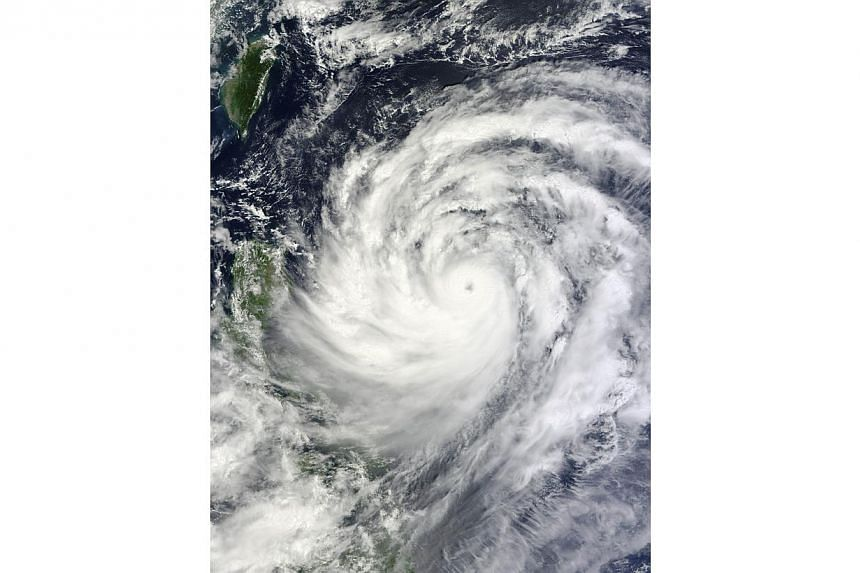 This Nasa Terra satellite image obtained on Thursday, Sept 19, 2013, shows Typhoon Usagi nearing the Philippines and southern Taiwan.Super Typhoon Usagi - one of the strongest storms of the year - barrelled towards Hong Kong and southern China