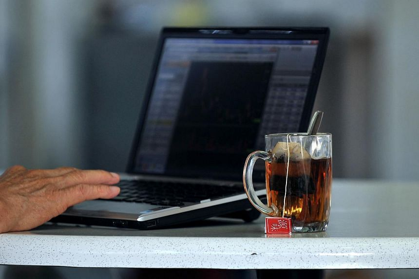 An elderly man uses his laptop at a coffeeshop. The Infocomm Development Authority of Singapore partnered the Organisation of Senior Volunteers (RSVP) and The Council for Third Age to launch an IT helpline on Sept 21, 2013. -- ST FILE PHOTO:NG