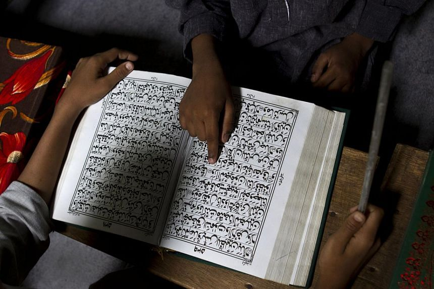 Muslim children take lessons on the Quran at a Madrasa or Muslim religious school in India on July 30, 2013. In Russia, senior Islamic clerics warned the country's leaders on Friday unrest could erupt in Muslim communities if a court decision orderin