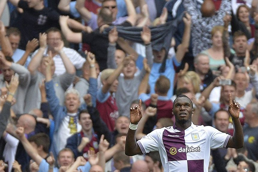 Aston Villa manager Paul Lambert played down the gravity of an injury that forced key striker Christian Benteke (above) off during his side's 1-0 win at Norwich City on Saturday. -- FILE PHOTO: REUTERS
