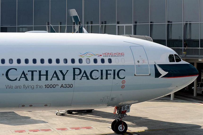 Hong Kong flag carrier Cathay Pacific said on Saturday it will cancel all flights, a day ahead of the anticipated arrival of Super Typhoon Usagi, the most powerful storm of the year. -- FILE PHOTO: AFP