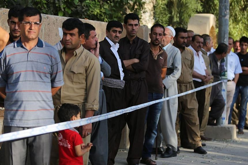 Iraq's Kurds voted on Saturday in their first election in four years as their autonomous region grapples with disputes with Baghdad while fellow Kurds fight bloody battles in neighbouring Syria. -- PHOTO: AFP
