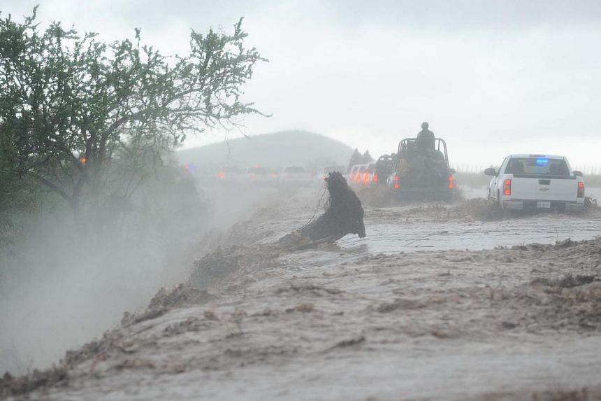 Residents of El Zapotillo are evacuated by the army because of the overflooding of the neighbouring river, in the state of Sinaloa, Mexico, on Sept 19, 2013. At least 101 people have been killed in landslides and flooding caused by especially heavy r