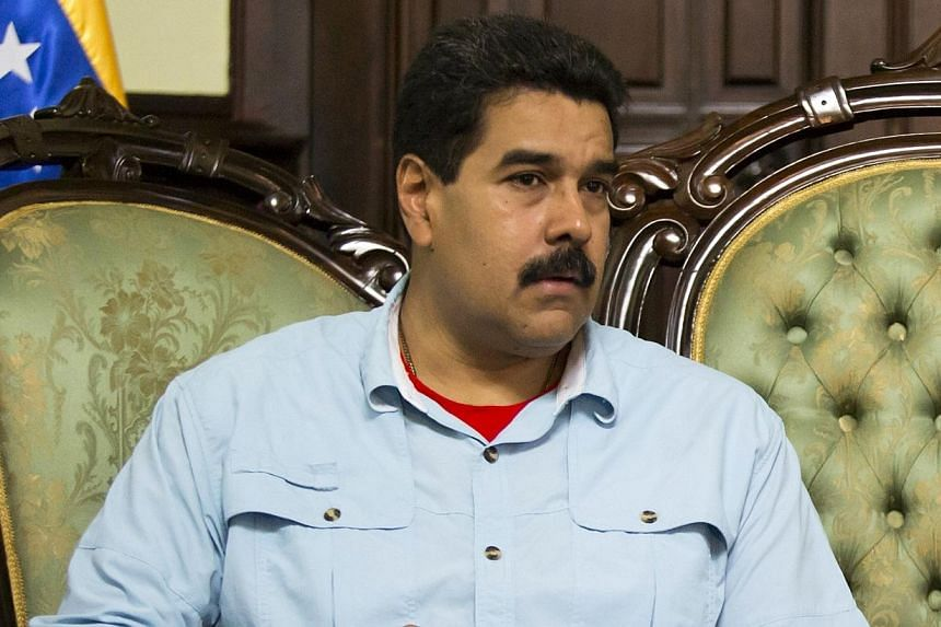 Venezuela's President Nicolas Maduro attends a meeting with South Africa's Foreign Minister Maite Nkoana-Mashabane in Caracas on Thursday, Sept 19, 2013. Mr Maduro said he had arrived in Beijing on Saturday after accusing the United States of re