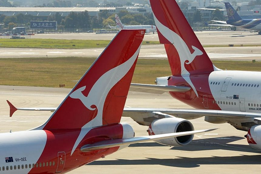 The Australian authorities were on Saturday investigating how two Qantas passenger planes got so close that it triggered a collision warning alert, forcing them to take evasive action. -- FILE PHOTO: AFP