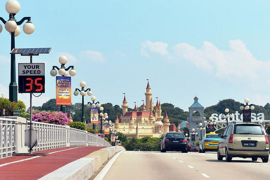Speed cameras and warning signs along the bridge to Sentosa. They are part of measures put in place over the last three years to enhance road safety on the resort island. -- ST PHOTO: ALPHONSUS CHERN