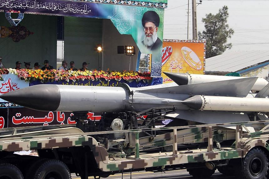 A military truck carries missile during the an annual military parade which marks Iran's eight-year war with Iraq, 1980-88, in the capital Teheran, on Sept 22, 2013. -- PHOTO: AFP