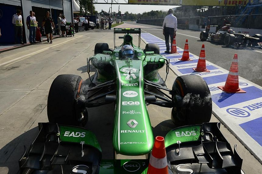 Formula One backmarkers Caterham have agreed a three-year contract extension with engine supplier Renault, the team said on Sunday. -- FILE PHOTO: AFP
