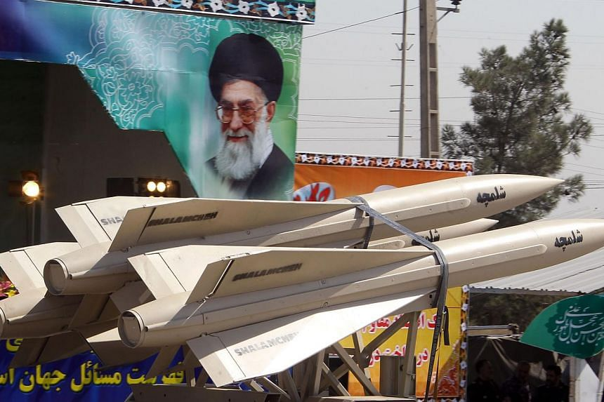 A military truck carries shalamcheh missile during the an annual military parade which marks Iran's eight-year war with Iraq, 1980-88, in the capital Teheran, on Sept 22, 2013. -- PHOTO: AFP