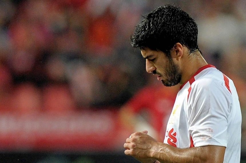 Liverpool manager Brendan Rodgers admits the return of Luis Suarez (above) cannot come soon enough after his side surrendered their unbeaten Premier League record with a 1-0 defeat against Southampton. -- FILE PHOTO: AFP