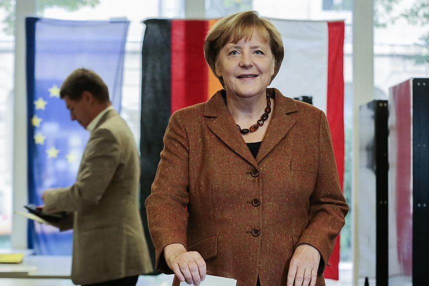 German Chancellor Angela Merkel, chairwoman of the Christian Democratic party CDU casts her vote in Berlin, Sunday, Sept 22, 2013. Germans voted on Sunday in a closely watched election that is likely to hand Merkel a third term at the helm of Europe'